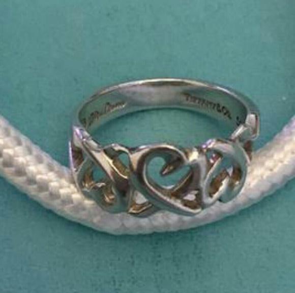 3ead90c21 Tiffany & Co. Paloma Picasso Triple Heart Ring. M_5c795e2ac2e9fe85676d81ba